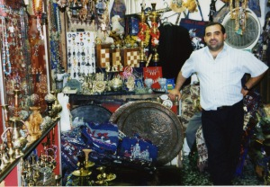 A shop keeper in his small Souq store